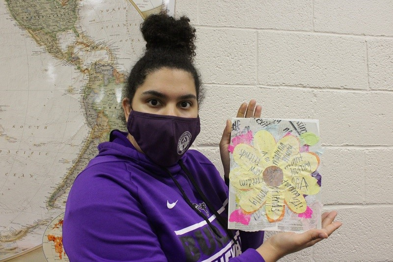 Micaila Holland is a business management junior. She is displaying her finished product that she worked on at painting night. (Mallory Graves/Staff photographer)