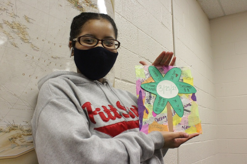 Nisa Muhammad is a business management junior. She presented her positive and negative thoughts onto her artwork as part of the instructions for the project. (Mallory Graves/Staff photographer)