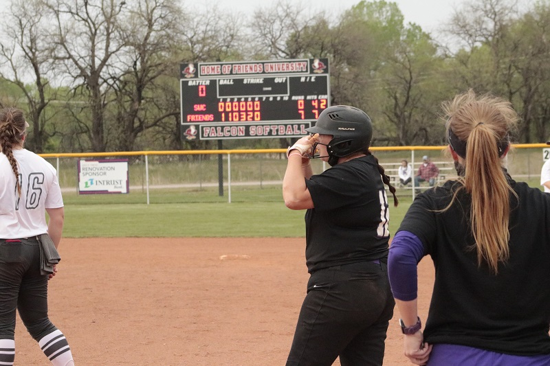 Cassidy Schubert, senior outfielder, stations at first after a base on ball. Schubert was hitless for the day. (RJay McCoy/Staff photographer)