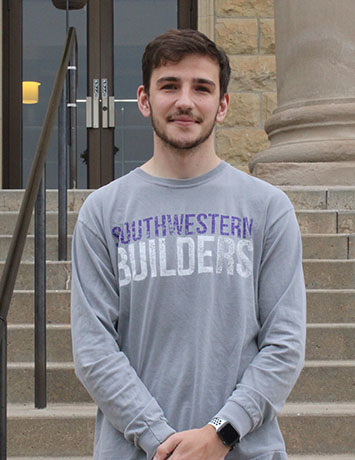 Braden Calvin, psychology senior, is from Lakin. Calvin will be heading to Oklahoma State University to pursue his doctorate from the school of psychology. (Daegiona Wilson/ Staff photographer)