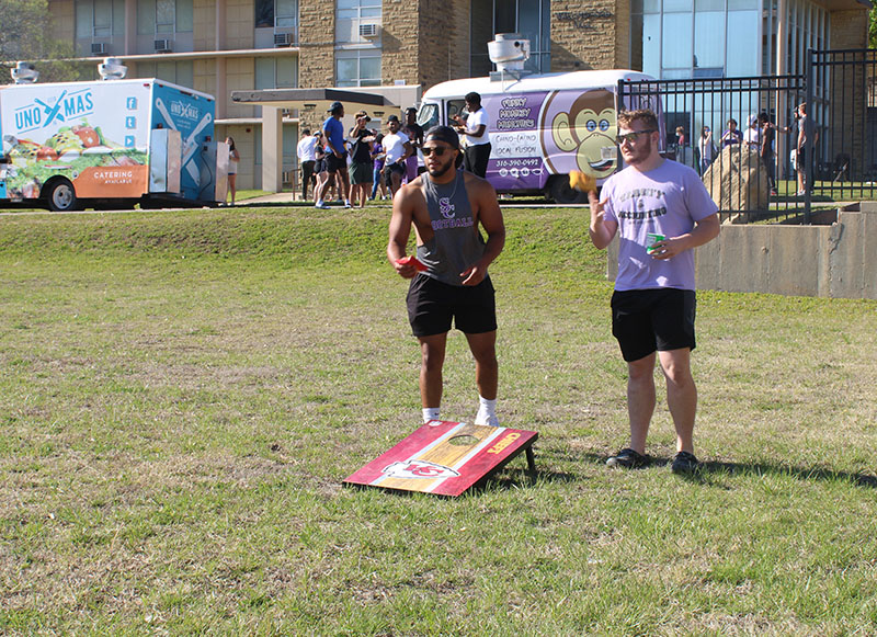 Kerry Coleman, business administration senior, and Shane Rodriguez, accounting junior, play corn hole with others. Corn hole and spike ball were both games that drew a lot of students. (Daegiona Wilson/Staff photographer)
