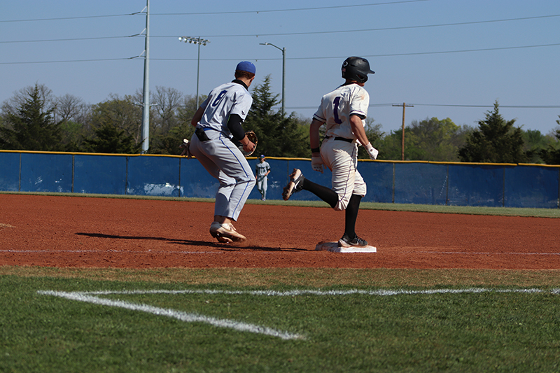 Sterling Spurling, sophomore infielder, loses the race to first base. Spurling hit the ball to center field before getting out. (Taylor Rodriguez/Staff photographer)