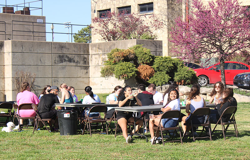 Individuals sat and ate, while interacting with each other as well as witnessing those on inflatables. The Block Party was an event put on by Student Life, that started at 5 p.m.(Daegiona Wilson/Staff photographer)