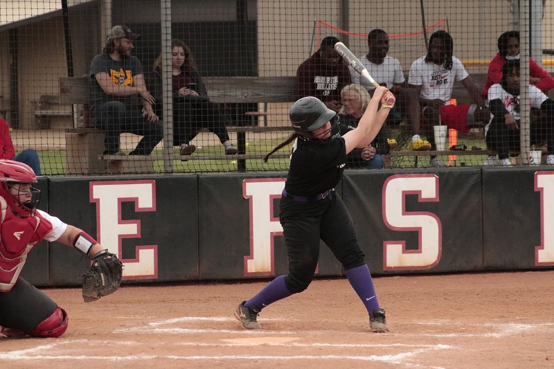 Jecca Autry, sophomore catcher, swings at a pitch. She was one-for-four at the plate. (RJay McCoy/Staff photographer)