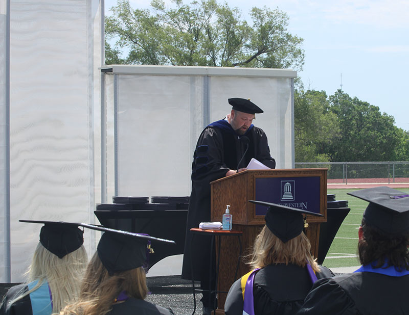 Dr. Jacob Goodson, associate professor of philosophy, gives the faculty address. The general theme was failure. Goodson spoke on embracing failure and finding a way to succeed when it happens. (Staff Photographer/ Daegiona Wilson)