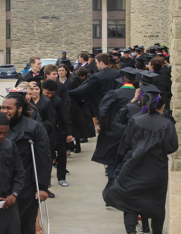 Graduates lineup for Southwestern College's 2021 commencement. It was held on May 9, 2021. (Daegiona Wilson, Staff photographer)