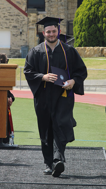 Curtis Rylant, business administration graduate, walks across the stage as he receives his diploma. Rylant is from Clearwater. (Staff Photographer/ Daegiona Wilson)