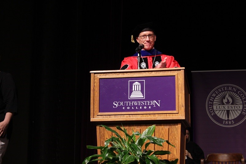 President Brad Andrews speaks at the Master's ceremony. He will shake hands with each Builder as he gives them their award that they earned. (Mallory Graves/Staff photographer)