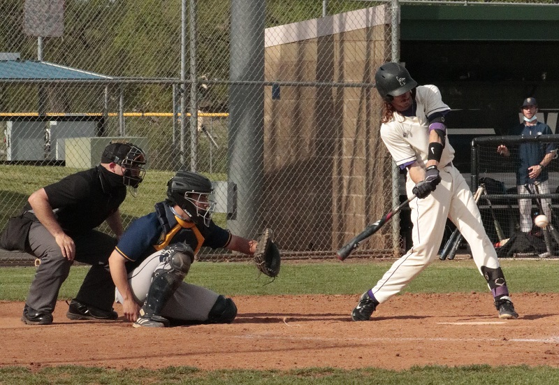 Jason Bray, junior utility player, takes a hack at an incoming pitch. Bray ended up going hitless at the plate for the day. (RJay McCoy/Staff Photographer)