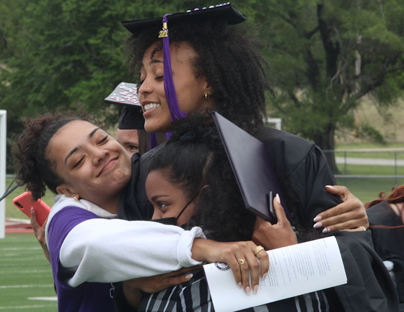 Sidney Dennis, physical performance and sport studies senior, is pictured with family. Dennis is from Oklahoma City. (Daegiona Wilson, Staff photographer)